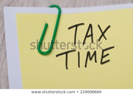 Stok fotoğraf: Vergi · zaman · yapışkan · not · yazılı · sarı · kırmızı