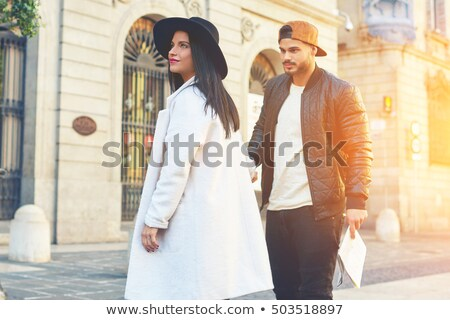 Two girlfriends walking during windy day Stock photo © konradbak