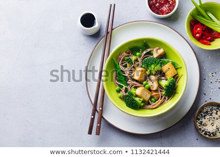 Bowl of chili pepper and broccoli soup Stock photo © juniart