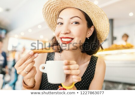 Foto stock: Glass Of Coffee With Churros