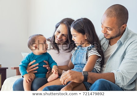 Young Mother Holds Newborn Baby Girl as Brother Looks On Stock photo © feverpitch