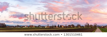 Stock photo: Sunset over a Village