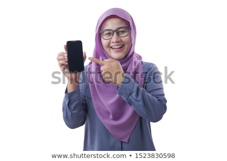 Muslim girl holding a mobil phone Stock photo © aza