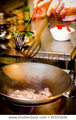 assorted stir fried vegetables in a pan with ladle stock photo © stryjek