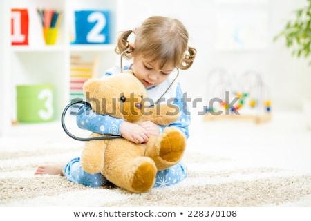 beautiful girl with toy bear Stock photo © PetrMalyshev
