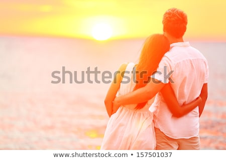 çift · el · ele · tutuşarak · birlikte · plaj · gün · batımı · balayı - stok fotoğraf © maridav