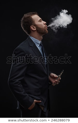 businessman smoking an electronic cigarette stock photo © wavebreak_media