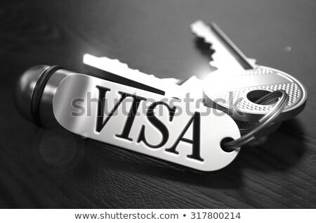 VISA kulcsok fekete fa asztal közelkép kilátás Stock fotó © tashatuvango