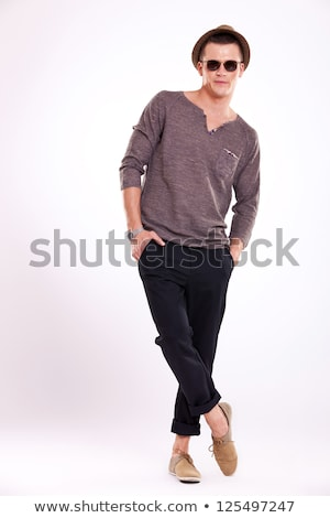 fashion man standing with his legs crossed Stock photo © feedough