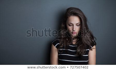 Sad beautiful woman looking down Stock photo © stokkete