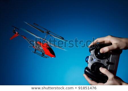 удаленных вертолета Flying закат радио синий Сток-фото © artfotoss