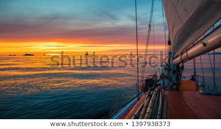 Sailing boat at sunrise in Atlantic ocean stock photo © Steffus