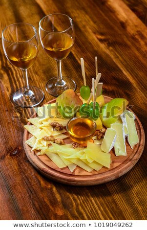 Camembert, Gouda And Brie Cheese Platter With Wine Glasses Stock photo © radub85