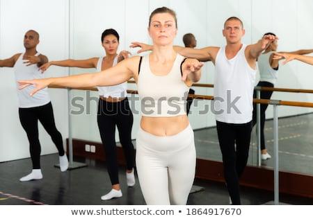 mince · danseur · ballet · posent · regardant · vers · le · bas · gris - photo stock © bezikus
