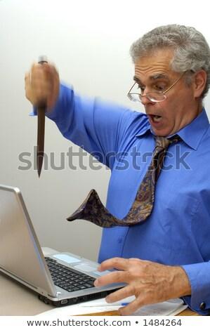 Man stabbing computer with knife. Stock photo © iofoto