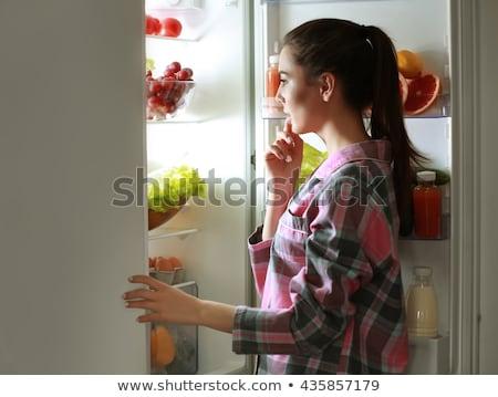 meia-noite · tarde · noite · mulher · jovem · comida - foto stock © lightsource