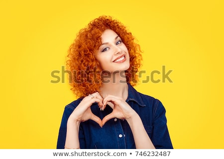 Portrait of red-haired signing woman Stock photo © julenochek