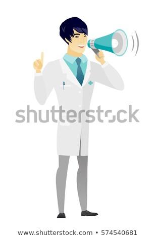 Jonge asian arts aankondiging megafoon Stockfoto © RAStudio