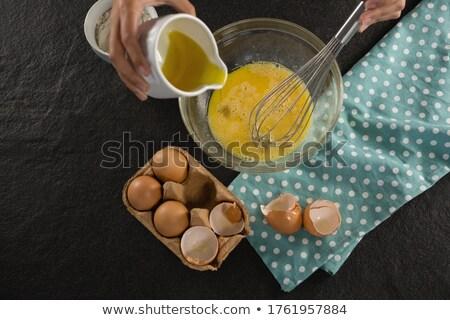 Nő olaj vesztes tojások tál középső rész Stock fotó © wavebreak_media