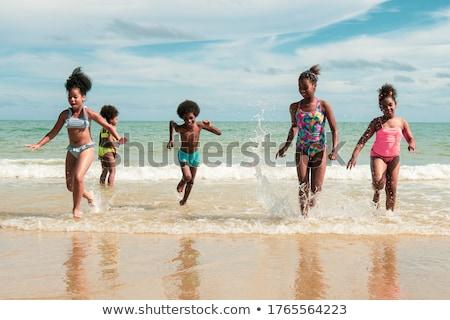 Grupy wyścigi plaży niebo człowiek lata Zdjęcia stock © IS2