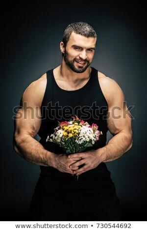 hombre · ramo · flores · sin · camisa · mano · mirando - foto stock © LightFieldStudios