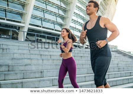 Stock photo: sportswoman and sportsman jogging in city