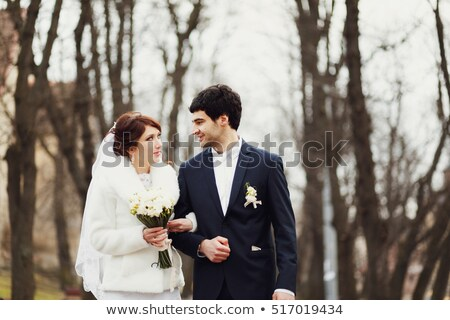 bride and groom relaxing in woods stock photo © is2