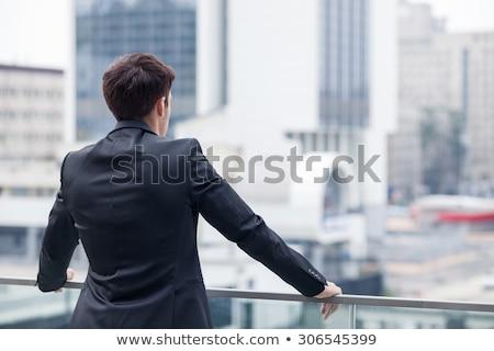 egészalakos · kép · fiatalember · megjavít · kabátujj · fiatal - stock fotó © feedough