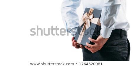 деловой человек предлагающий подарок костюм портрет Рождества Сток-фото © IS2