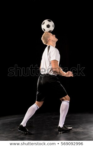 Man bouncing soccer ball on his head Stock photo © IS2