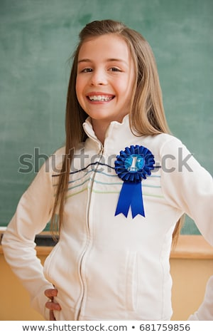 Stock photo: Schoolgirl wearing a rosette
