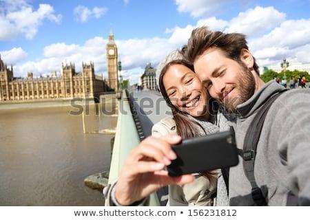 Couple taking self portrait on bridge Stock photo © IS2