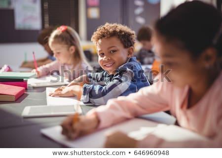 Ritratto sorridere scolaro compiti per casa classe scuola Foto d'archivio © wavebreak_media