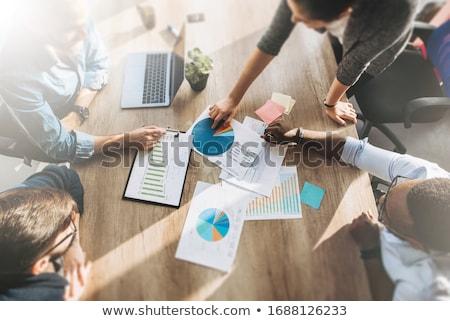 coworkers discussing diagram graphs stock photo © jossdiim