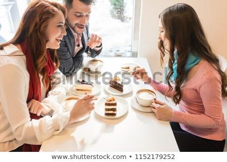 Boldog pár ül asztal kölcsönös barát Stock fotó © Kzenon