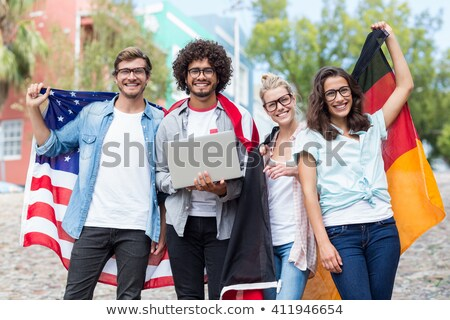 blonde holding national flags stock photo © jossdiim