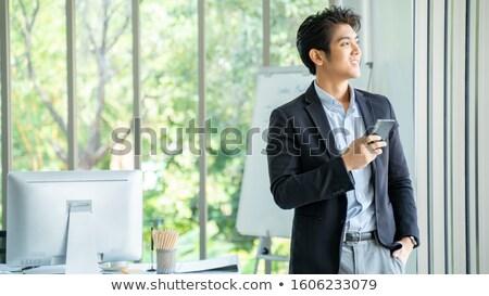 Portre işadamı dizüstü bilgisayar kullanıyorsanız iş bilgisayar Internet Stok fotoğraf © Minervastock