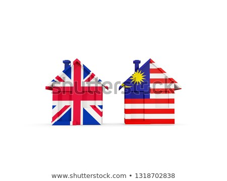 Two houses with flags of United Kingdom and malaysia Stock photo © MikhailMishchenko