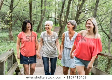senior and young woman gardening together stock photo © kzenon