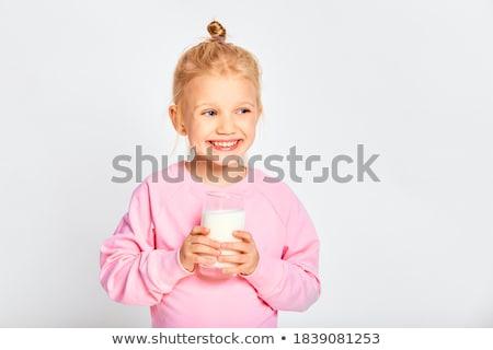 Cute girl 4-5 year old posing in studio with milk Stock photo © Lopolo