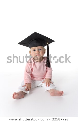 A Portrait of a sitting baby girl with a graduation cap Stock photo © Lopolo