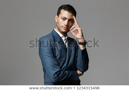 image of serious arabic businessman 30s in formal suit holding p stock photo © deandrobot