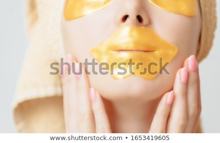 Stock photo: Woman touching the skin under her eye
