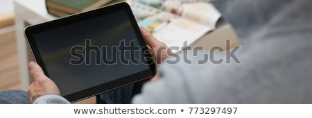 Hand holding tablet with music play concept Stock photo © ra2studio