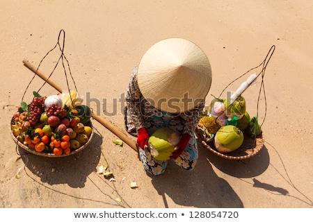 watermelons in the vietnamese market stock photo © galitskaya