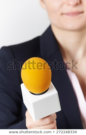 Abstract Shot Of Female Journalist With Microphone Stock photo © HighwayStarz