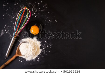 Banner with utensils, flour and egg on black background. Stock photo © Illia