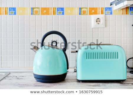 Close up view on work top two objects set, toaster electrical de Stock photo © amok