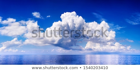 Blue sky landscape with big cumulus clouds. Stock photo © artjazz
