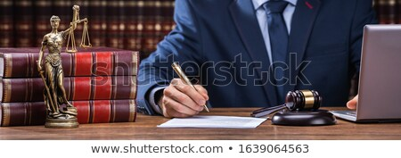 Lawyer Signing Documents Near Mallet And Laptop Stock photo © AndreyPopov